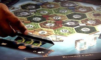microsoft surface settlers of catan blends analog and digital gameplay